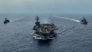 USS Ronald Reagan (CVN 76), Ticonderoga-class guided-missile cruiser USS Chancellorsville (CG 62) and Japan Maritime Self-Defense Force Akizuki-class destroyer JS Fuyuzuki (DD 118) underway in formation while conducting a bilateral exercise. 27 Oct 2019